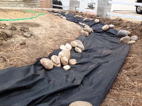 dry creek bed with weed barrier fabric