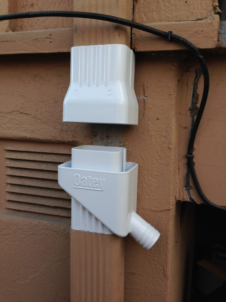 connecting the two ends of the downspout
